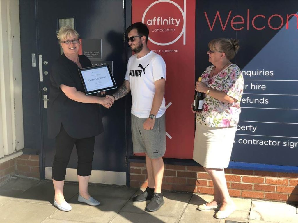 declan being rewarded for help at Aston Services Group